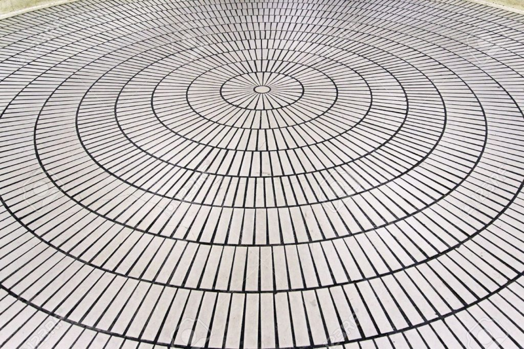 Floor ceramic tiles in concentric circles formation